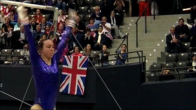 GB's Beth Tweddle dismounts the bars