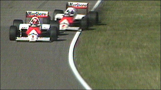 Niki Lauda holds the challenge of team-mate Alain Prost