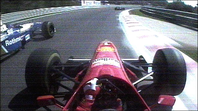 Jacques Villeneuve gets past Michael Schumacher