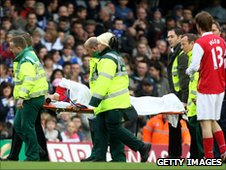 Eduardo is taken off on a stretcher after breaking his leg against Birmingham in February 2008