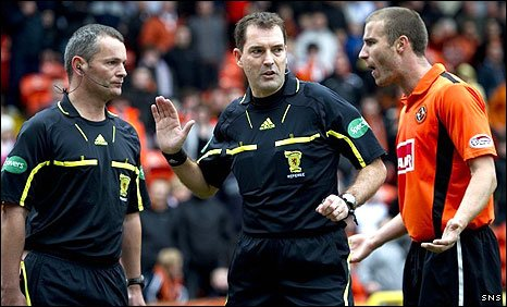Assistant referee Steven Craven, referee Dougie McDonald and United's Sean Dillon
