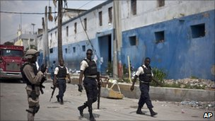 Police officers at the entrance to the National Penitentiary in Port-au-Prince, Haiti - 17 October 2010