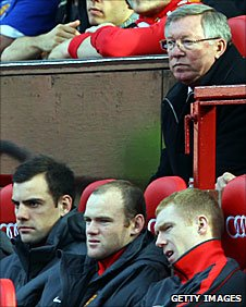 Manchester United manager Sir Alex Ferguson (top) and Wayne Rooney during Saturday's game against West Brom
