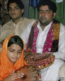 Azhar Haidri (right) sits with relatives during his first wedding ceremony in Multan on Sunday