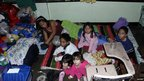 A family at a school turned into a shelter during the typhoon