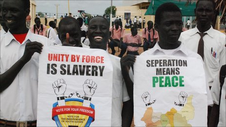 Supporters of independence hold up posters reading 'Unity by force is slavery' and 'Separation means peace'