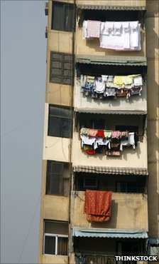 Modern high-rise building in Cairo with clothes hanging out to dry from the balconies