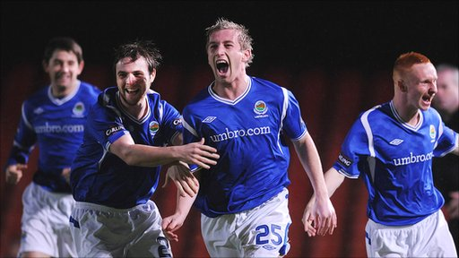 Linfield players celebrate their 8-1 victory over Crusaders