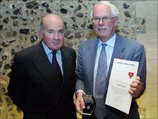 YMCA Norfolk president, Sir Richard Dannatt (left) and outgoing president, Richard Jarrold with his Order of the Red Triangle (Picture: YMCA)