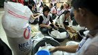 Red Cross volunteers prepare aid supplies in Manila, Philippines (19 Oct 2010)