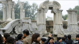 Visitors look at the Guanshuifa Fountain at the Old Summer Palace