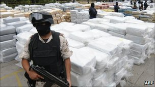Members of the security forces guard confiscated marijuana in Tijuana, 18 October 2010