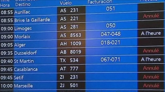 Airport departure board shows flight cancellations