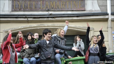 High school students block the entrance to the Lamartine high school in Paris, on 12 October 2010, to protest against the government reform bill on pensions.