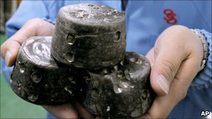In this undated photo, chunks of chemically processed rare earths are shown in Beijing