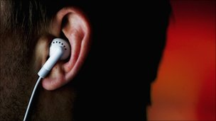 Earphones from an iPod in an ear