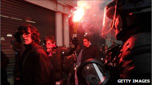 Students face riot policemen as clashes appeared between students and police during a demonstration against the pension reform on October 14 2010 in Dijon, eastern France.