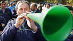 A member of Romania's police and prison officers' union blows a vuvuzela at a protest against cuts in Bucharest, 15 October