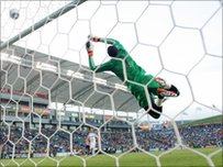 Los Angeles Galaxy keeper Donovan Ricketts pushes the ball wide and over the net for the save during an MLS match against Chivas USA