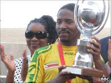 Captain Method Mwanjali lifts the Cosafa Cup last November with Henrietta Rushwaya looking on