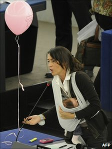Italian MEP Licia Ronzulli, with her baby, speaks during the debate on maternity leave in Strasbourg