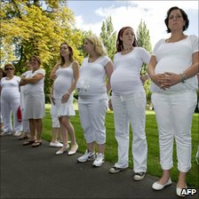 Pregnant women at a protest calling for better benefits for mothers worldwide, Breda, Netherlands, 4 September