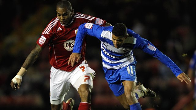 Marvin Elliott tries to hold off Readin's' Jobi McAnuff