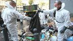 Civil protection unit members requisitioned by the French authorities clean the streets and piled-up rubbish in Marseille on the ninth day of a strike by rubbish collectors on 20 October
