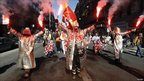 Arcelor Mittal steel workers dressed in protective suits demonstrate over pension reforms in Marseille on 19 October