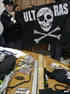 Police displaying weapons found after they arrested three Napoli fans