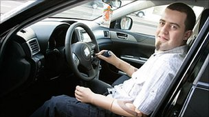 Christian Kandlbauer sitting in a specially adapted car