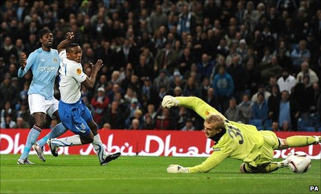Emmanuel Adebayor (left) scores his first