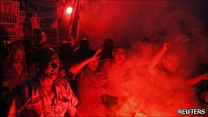 Demonstrators light flares during the protest in Buenos Aires