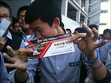 A fan shows his free ticket