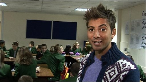 Ricky in a classroom as part of his investigation into school uniform!