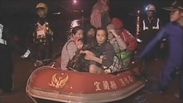 People being rescued in boat