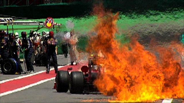 Fire behind Kimi Raikkonen's Ferrari