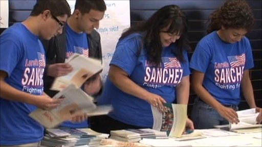 The campaign team for Democrat Loretta Sanchez sort posters and leaflets