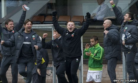 Celtic manager Neil Lennon celebrates Celtic's win at Tannadice