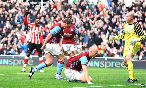 Aston Villa defender Richard Dunner scores an own-goal against Sunderland