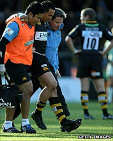 Riki Flutey being helped from the field