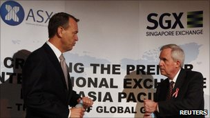 SGX CEO Magnus Bocker (left) and ASX CEO Robert Elstone (right)