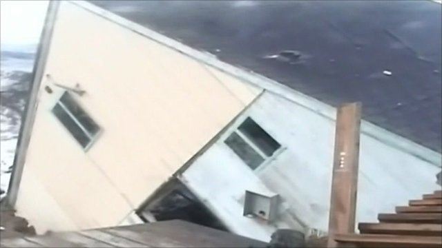 House washes into sea