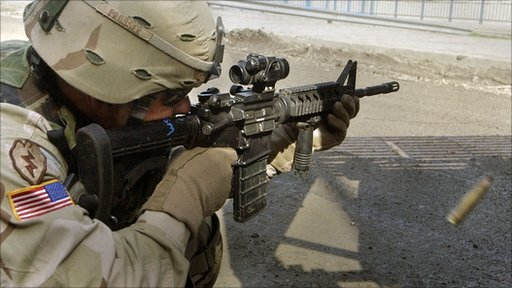 US infantry soldier during a gun battle with insurgents in Mosul, Iraq 2005