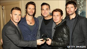 Take That with their award