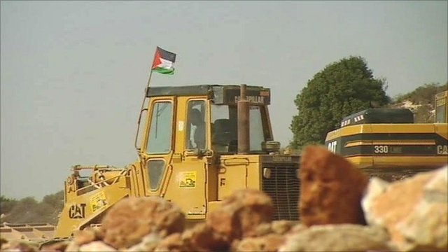 Palestinian digger in West Bank