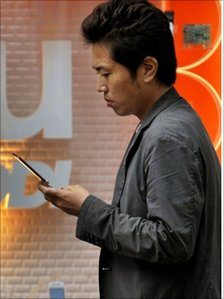 Japanese man using a mobile phone