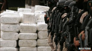 Mexican soldiers stand guard by a huge haul of marijuana seized in Tijuana