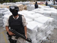 Members of the security services guard seized marijuana