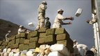 Mexican soldiers unloading packages of marijuana, Tijuana